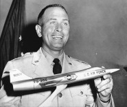 Capt_Walter_W._Irwin_holding_F-104_model_after_speed_record_AP_Wire_Photo
